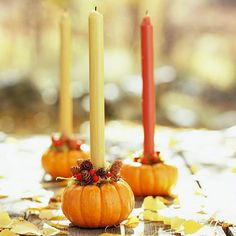 Miniature pumpkins become festive candle holders! More decorating ideas: http://www.bhg.com/decorating/seasonal/autumn/fall-harvest-decorating-ideas/