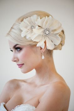 I can see this plopped onto a head full of unruly curls for spring.   Also gorgeous on this pinned up look