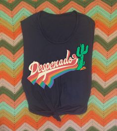 Desperado 70s Retro Muscle Tee 70s style Muscle tee in the softest 100% vintage style fabric made 100% in the USA Raw cut arm holes and hem give it that little extra edge! Printed with water based ink