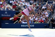 Maria Sharapova of Russia serves during her women's singles semifinal match against Victoria Azarenka of Belarus on Day Twelve of the 2012 US Open