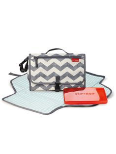 This portable diapering kit from Skip Hop ensures that baby is always clean, dry and happy! It features an extra-wide changing pad that's easy to wipe clean and has a cushioned head area with the innovative Pronto pillow. It also has a baby wipes case, a mesh pocket to fit diapers and creams, and a front zipped pockets for your personal belongings. Perfect for shopping or running errands!<br /><br />- Perfect to store in a bag<br />- Handle to attach t...