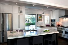 Past Present Perfect: The kitchen needed the most updating, and now blends into the dining room, which then leads to the patio and backyard.