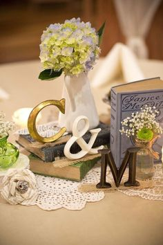 Love the initials as part of the centerpieces for a personal touch with the Bride & Groom's initials