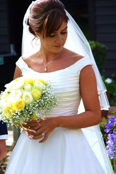 Roses and gypsophila in whites and yellows in this summer bouquet at Blake Hall