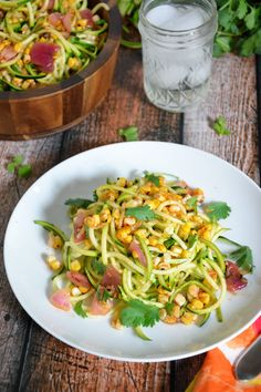 Roasted corn is paired with spiraled zucchini, red onion & tossed with a simple chili lime vinaigrette for a fresh, make ahead, summer roasted corn salad!