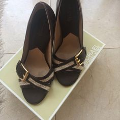 Michael Kors heels Brown Michael Kors heels with braided light brown straps. Wear on the bottoms but otherwise in good condition. MICHAEL Michael Kors Shoes Heels