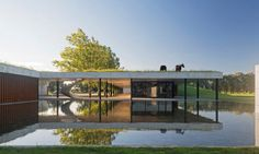 Estudio Ramos designed Figueras Stables, a stunning contemporary building with a native grass green roof.