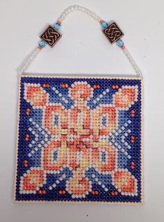 This Sunset Snowflake is available from Frony Ritter Designs. This ornament is stitched and beaded.
