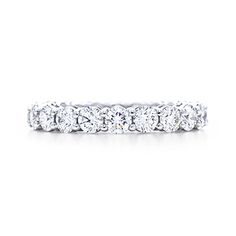 Shared-setting band ring with diamonds in platinum, 3mm wide. nice little wedding band. haha