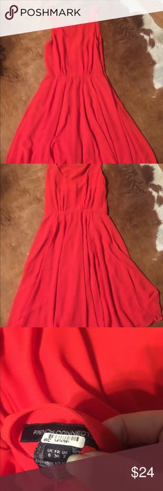 Beautiful RED French Connection dress NWOT Sz 2 Stunning Red French connection dress. This dress is a gorgeous color. The dress is fitted at the waist and then is flows for a beautiful feminine detail. The back drops slightly lower than the front neckline but not too low you can't wear a bra. US Sz 2 French Connection Dresses Midi