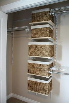 Closet organization that I love! Baskets in the middle is a great idea. And having multiple areas to hang things is perfect for organizing clothes!