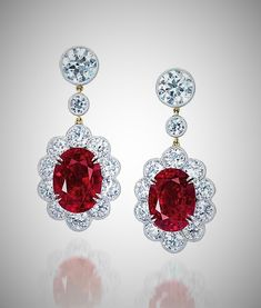 """A superb pair of 10.02 and 9.09 carats Mogok Burma """"pigeon blood"""" oval-shaped ruby and diamond ear pendants"""