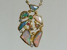 Fine gold and 18 k yellow gold necklace with 8 opals and 4 sapphires.... €2,010.00, via Etsy.