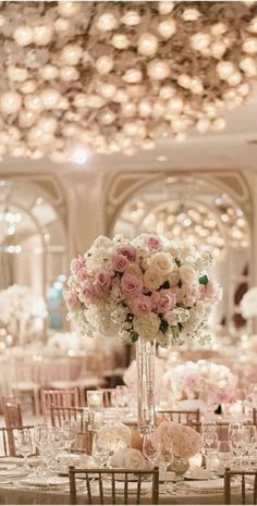 Romantic and classic white and pink wedding decor with tall centerpieces