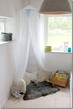 easy nook - pillows, rug, box of books