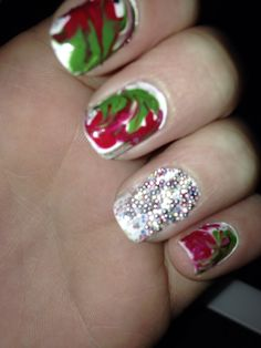 Christmas 2013 - red and green water marble with little beads on an accent nail