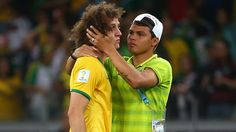 Thiago Silva attempts to comfort David Luiz after Brazil are knocked out.