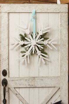 DIY Snowflake ~ The materials for making a large snowflake start with 6 paint sticks. For smaller snowflakes you use Popsicle sticks, along with a combination of assorted wood craft sticks, squares and shapes all found at craft stores in bags of multiple sizes and shapes