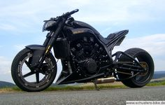 The Evil Relikt. I'm not convinced that I like the length of the swing arm on this one but it's definitely a spectacular build. A shorter swing arm might make it look too close to a Buell. Based on a Yamaha V-Max thanks to some astute followers!
