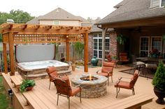 Awesome hot tub install with a stone surround. This is amazing!