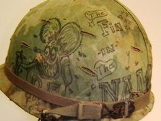 Vietnam Helmet Art   Helmet Used in Vietnam with Original Graffiti on Helmet Cover. \