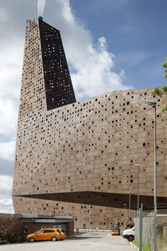 Erick van Egeraat's Roskilde power plant has a glowing perforated facade.    Architecture industrial. Architect  Erick van Egeraat has completed a waste incinerator and power plant in the Danish city of Roskilde with a spotty perforated facade that lights up at night as if there's a fire burning within.