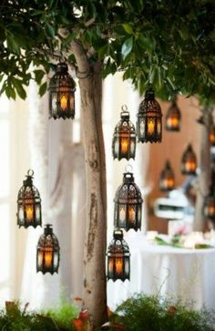 Lanterns with hanging white feathers dipped in gold?
