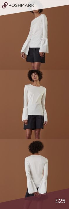 Finery white flounce sleeve top. Finery - oversized puffs on exaggerated cuffs team new age, weatherproof style fabric with olden era styling on this high finish jersey style white tee. 100% cotton body & sleeve with 100% weatherproof cuff. Great on its own or makes a great layering piece. Shirt is labeled U.K. 10 which is equivalent to a US 6. Finery Tops Tees - Long Sleeve