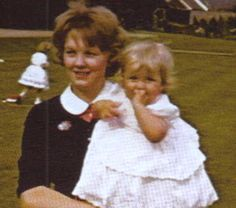 Princess Diana being cuddled by her nanny.