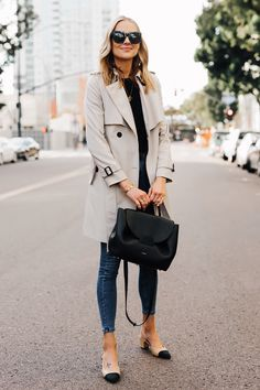 Blonde Woman Wearing Trench Coat Black Sweater Denim Skinny Jeans Chanel Slingbacks Polene Number One Handbag Monochrome Black Fashion Jackson San Diego Fashion Blogger Street Style