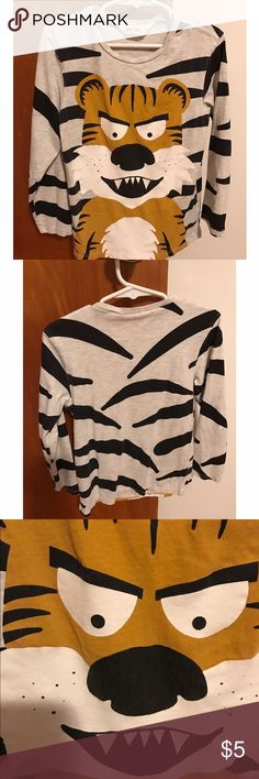 H&M boys 4-6 tiger long sleeve H&M boys size 4-6 tiger stripe long sleeve shirt. Very cute and unique. Lightly worn. Some minor fading from wash on the black areas of tiger face. Still in great used condition. H&M Shirts & Tops Tees - Long Sleeve