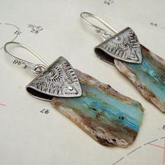Raw Blue Opal Slab Earrings by melissamanley on Etsy: love the detail and upscale feel of the silver with detailing wrapped around the rough rock piece.