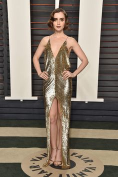 Lily Collins wearing Saint Laurent at the 2016 Vanity Fair Oscar Party in Beverly Hills, CA Lily Collins, Gold Dress, Sequin Dress, Glitter Dress, Celebrity Red Carpet, Celebrity Style, Glamour, Saint Laurent, Oscar Fashion