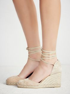 Carina Suede Espadrille Wedge | Made from beautiful Spanish craftsmanship, these suede espadrilles feature a woven jute wedge and a canvas heel.  Adjustable ties at the ankles and lined with leather.