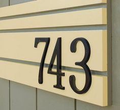 House number sign-> so cool!!! to give a line of color to the front of the house- love the off-centered #s!!!!!