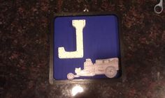 Letter Plaque. This is a simple wooden plaque. I painted it, added the first initial of his name, and then took a car that my son drew and modge podged it to the plaque to personalize it a little more.