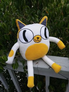 Cake the Cat from the TV show Adventure time large sized Plush toy cream and yellow colored kitten with regular cat eyes, aka jake the dog