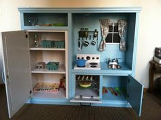 This was an old tv stand! A little paint and a few readjustments here and there and BAM! Dream kitchen for the kid! Such a cool idea!