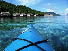 Kayaking in Raja Ampat, West Papua, Indonesia.
