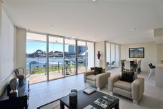 Simplicity is key to styling a lounge room with a view like this.