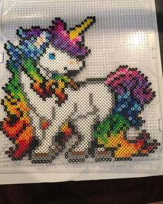 It's so pretty! #perler #beads #rainbow #unicorn #rainbowunicorn Crochet Unicorn Pattern, Unicorn Cross Stitch Pattern, Pearler Bead Patterns, Perler Patterns, Pixel Art, Art Perle, Hama Beads Design, Peler Beads, Iron Beads