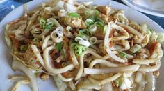 The teppanyaki udon with chicken is made with crunchy cabbage, onions, julienne carrots, peanuts and thick udon noodles. Jacky Chan Sushi, Wichita, Kansas