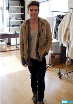 Great style. low neck tee, cardigan showing out of jacket sleeves, boots. Jeremiah Brent