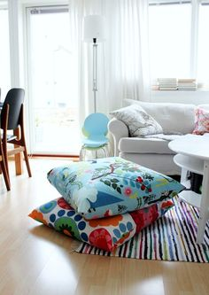 diy floor pillows - love this idea. Stack if colorful floor pillows in a corner.