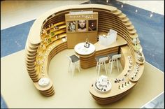 Make-u Kiosk----seems interesting and the idea of a walk-in kiosk is all the more enticing, plus the chairs could be used for Nail Art-Could pitch it to Make-up studio or the likes. quiosque