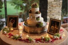 Our parents wedding pictures at cake table