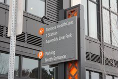 Wayfinding sign at Assembly Row in Somerville, MA. Engineering and fabrication by DCL. Design by Forseer. #dclbuilt #parking #wayfinding #sign
