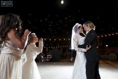 Bride, groom, First Dance, kiss, nighttime wedding, dress, bubbles, blowing, flower girl