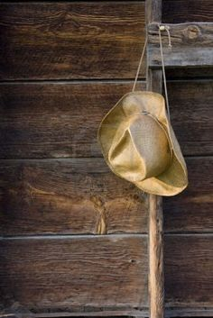 Farmers Hat Hanging On The Barn Ladder