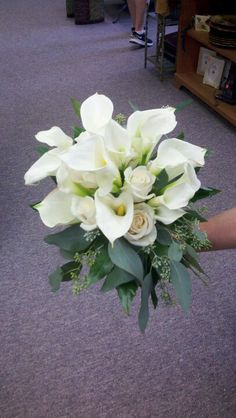 Cala lilies and roses by Picalily Flowers.
